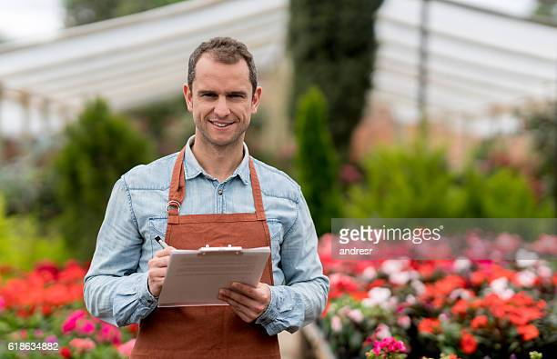 Business man working at a greenhouse