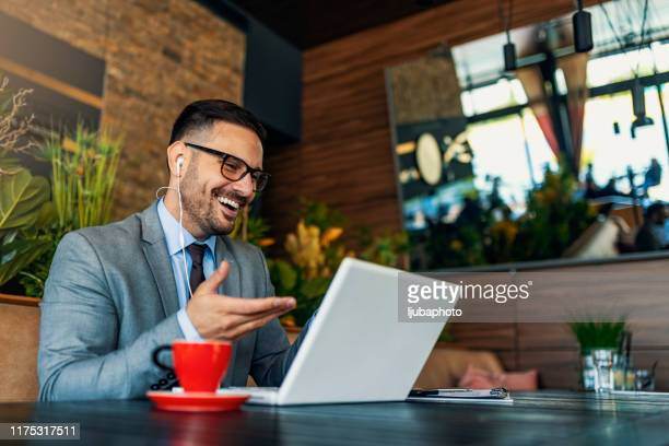 business man working at a restaurant - online dating stock pictures, royalty-free photos & images