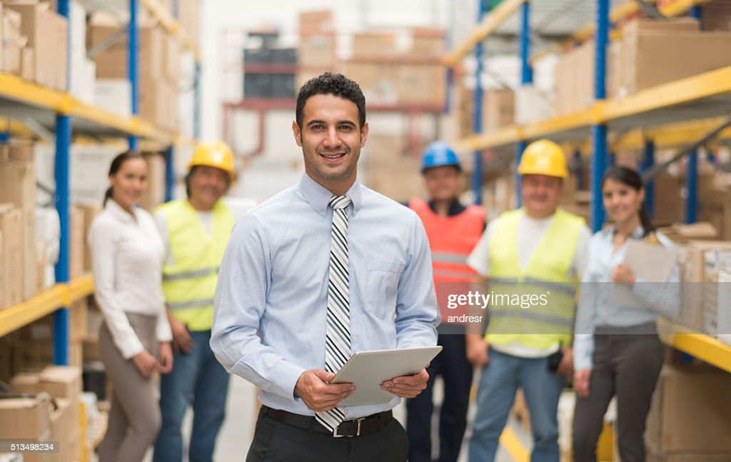 Business man working at a warehouse : Stock-Foto