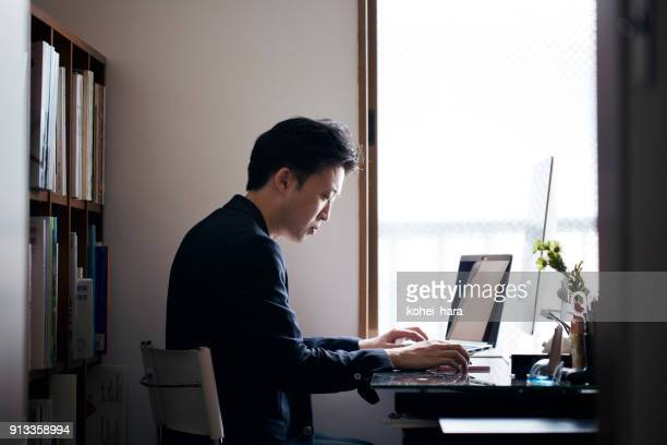 business man working from home - east asia stock pictures, royalty-free photos & images