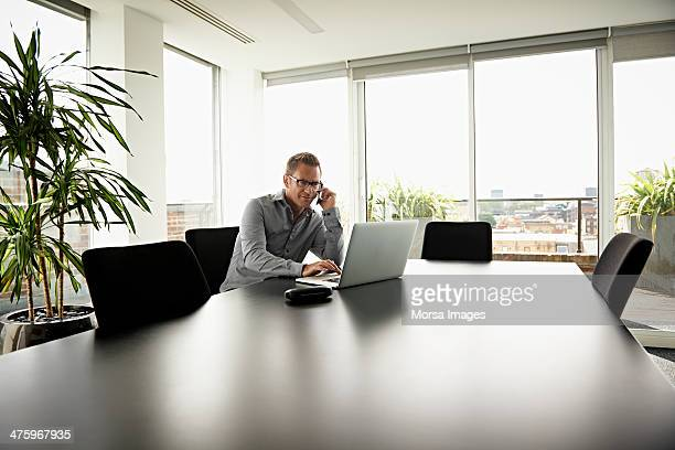 business man working in modern office - office laptop stock pictures, royalty-free photos & images