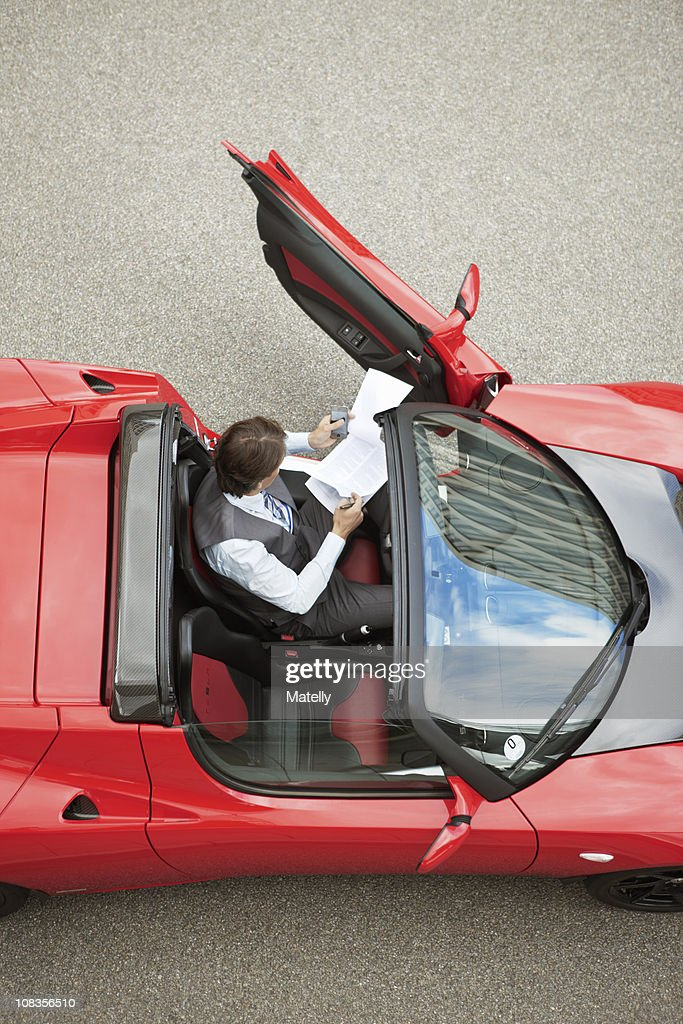 Business Man Working Near Electric Car Stock Photo | Getty Images