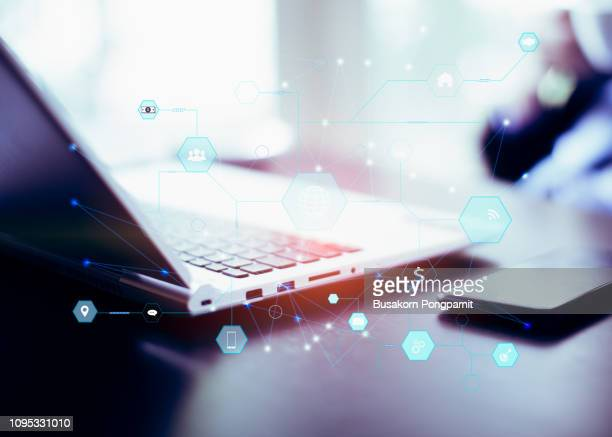 business man working on blank screen laptop computer on wooden desk as concept, media technologies for business. - risk stock pictures, royalty-free photos & images