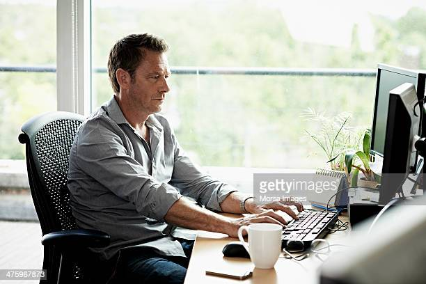 business man working on computer - sitting stock pictures, royalty-free photos & images