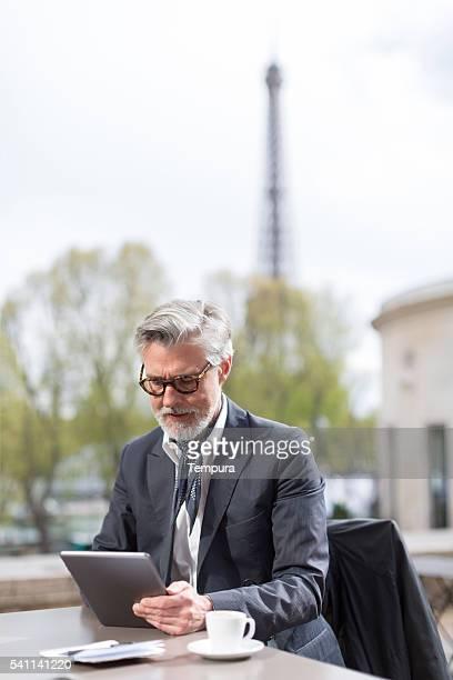 Business man working outdoors near the eiffel tower