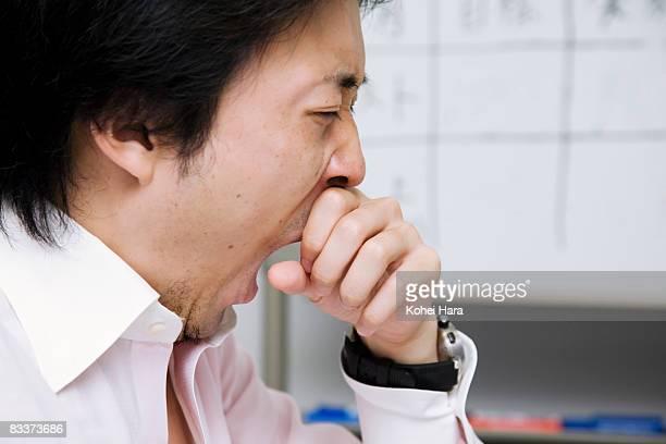 business man yawning at office - あくび ストックフォトと画像