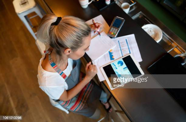business manager doing the books at a bar - finance stock pictures, royalty-free photos & images