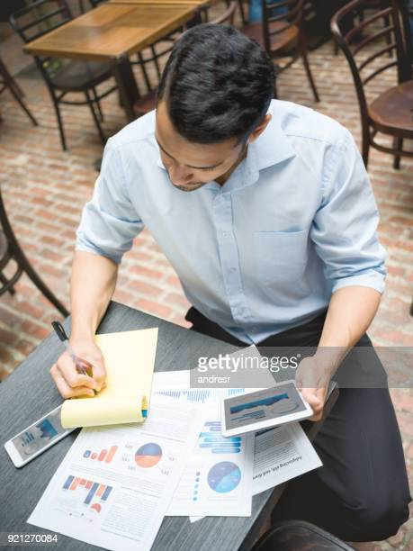 Business manager doing the books at a restaurant
