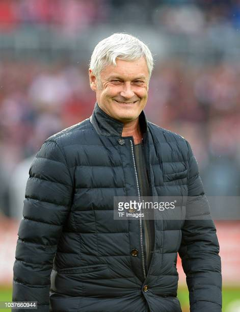 Business Manager of sports Armin Veh of FC Koeln laughs prior to the Second Bundesliga match between SV Sandhausen and 1. FC Koeln at BWT-Stadion am...