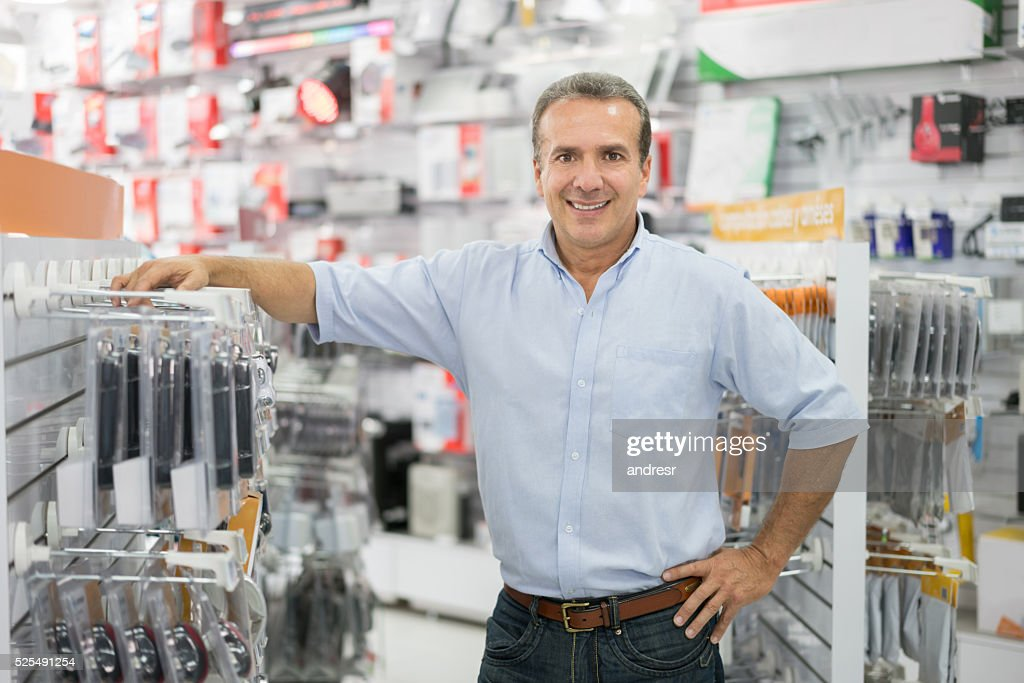 Business manager running a tech store : Stock Photo
