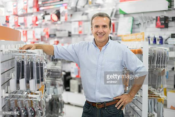 Business manager running a tech store