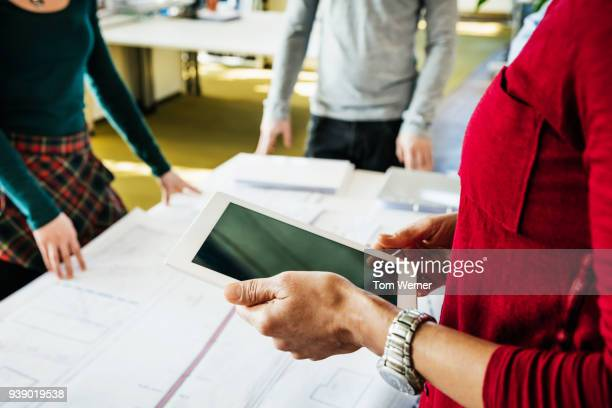 business manager using tablet during meeting - red pants stock pictures, royalty-free photos & images