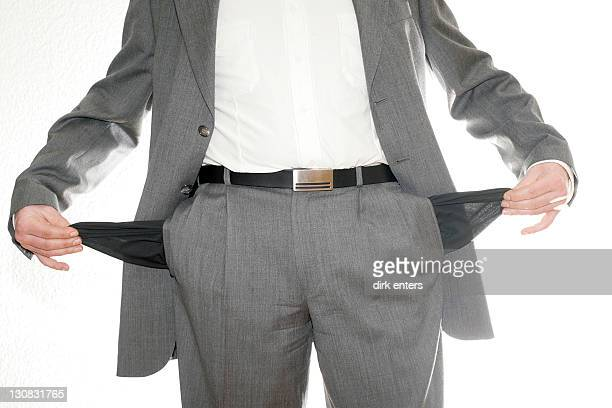 business manager with no money in his pocket is totally washed out - pocket stock pictures, royalty-free photos & images