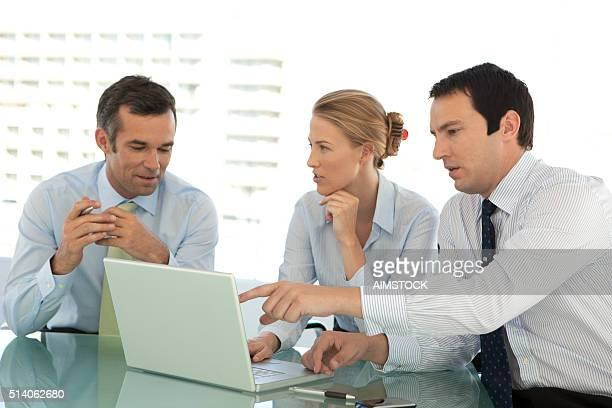 Business managers team working together at a meeting