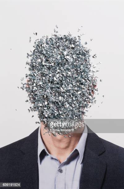Business mans face covered with metal shavings