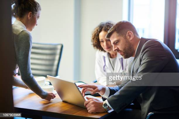 business medical meeting - administrator stock pictures, royalty-free photos & images