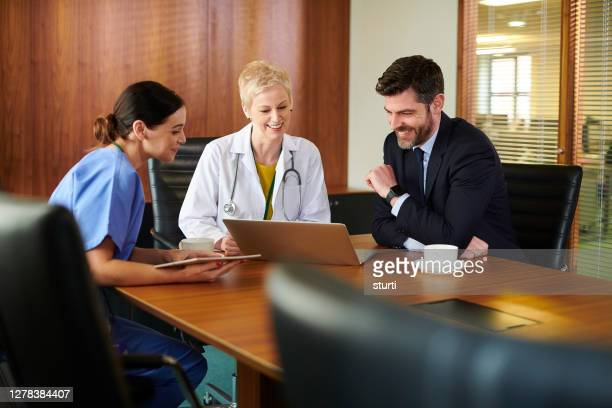 business medical meeting - hospital stock pictures, royalty-free photos & images