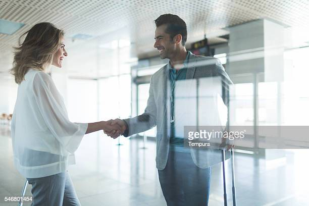 Business meeting and handshake in the airport