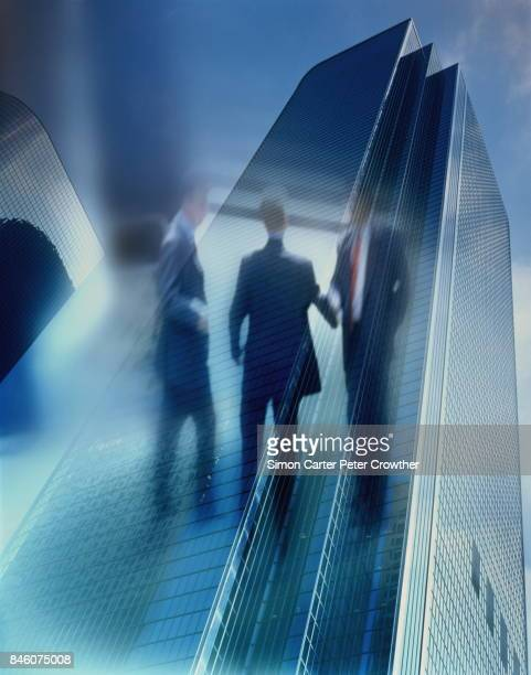 business meeting and high-rise buildings. - mergers and acquisitions stock pictures, royalty-free photos & images