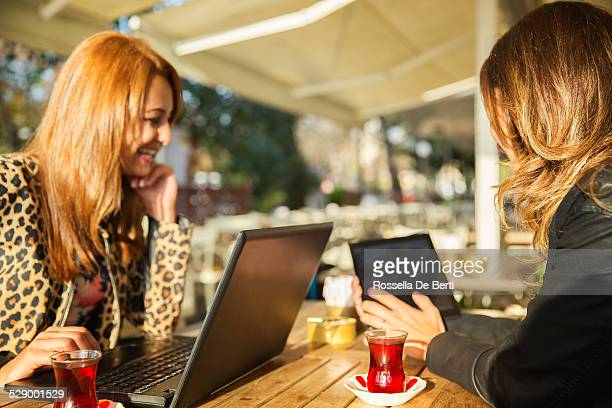 Business Meeting At The Cafè - Women