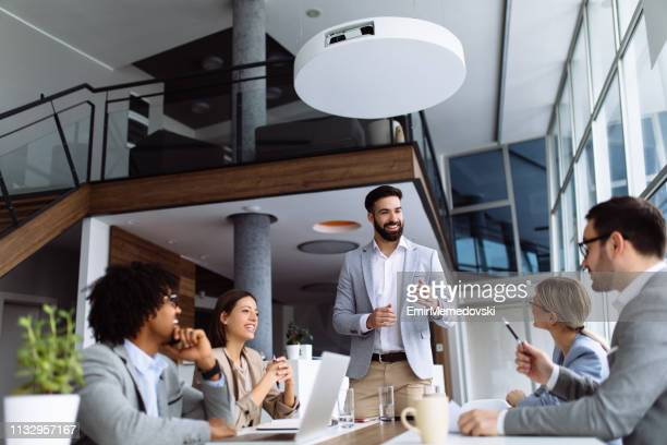 business meeting in a conference room - staff meeting stock pictures, royalty-free photos & images