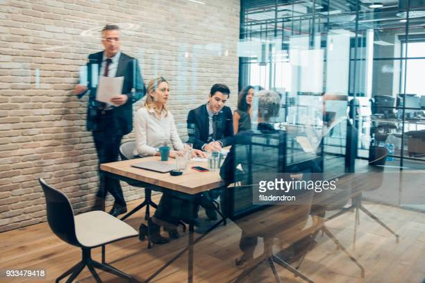 business meeting in a conference room - corporate business stock pictures, royalty-free photos & images