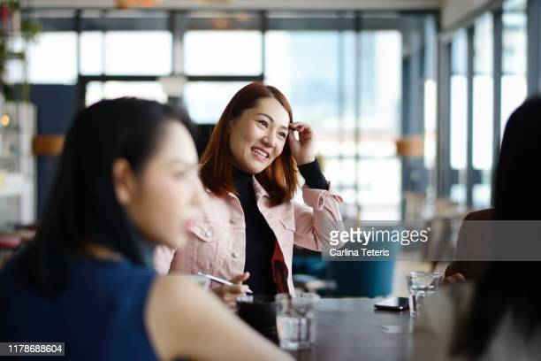 business meeting in a lounge - southeast asia stock pictures, royalty-free photos & images