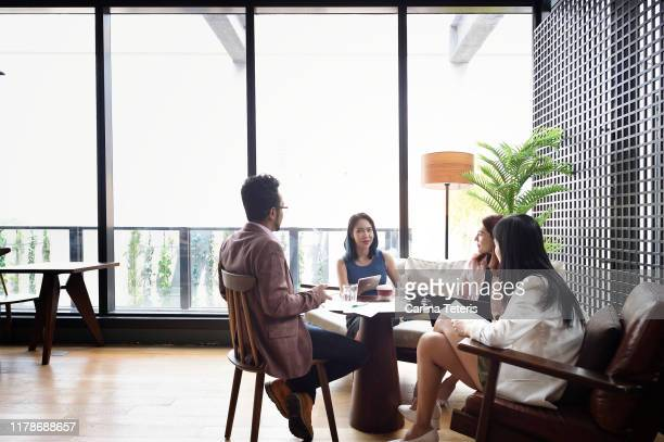 business meeting in a lounge - finance and economy stock pictures, royalty-free photos & images