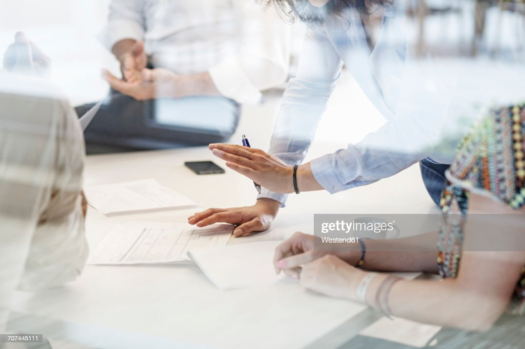 Business meeting in conferene room behind glass wall : Stock-Foto