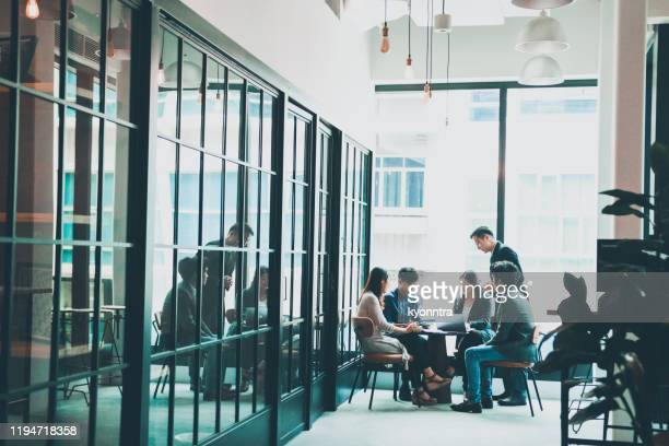business meeting in co-working space - south east asia stock pictures, royalty-free photos & images