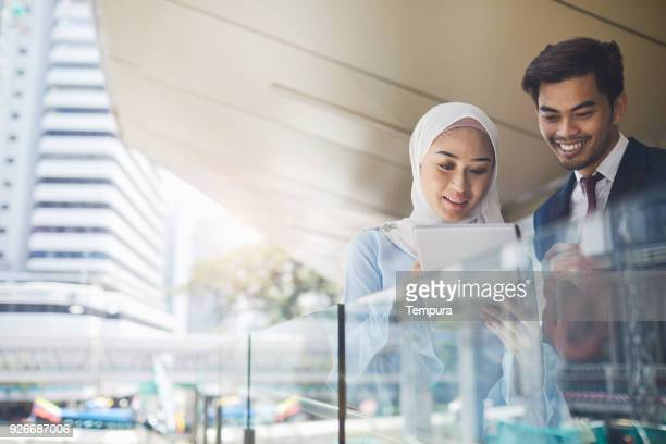 business meeting in kuala lumpur. - islam stock pictures, royalty-free photos & images