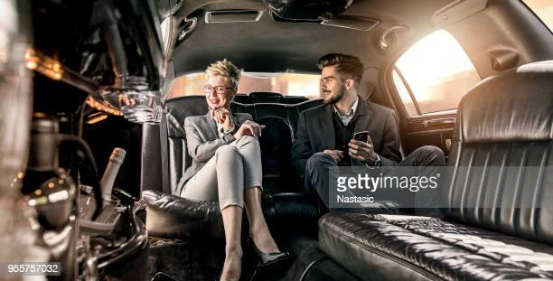 business meeting in limo - limousine stock pictures, royalty-free photos & images