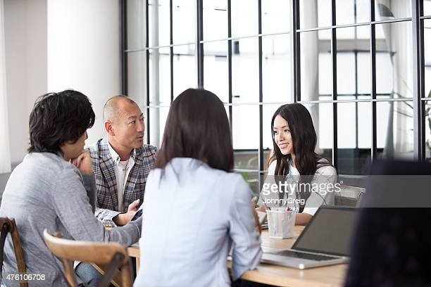Business meeting in modern Asian office