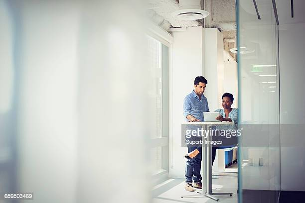 business meeting in office - rolled up sleeves stock pictures, royalty-free photos & images