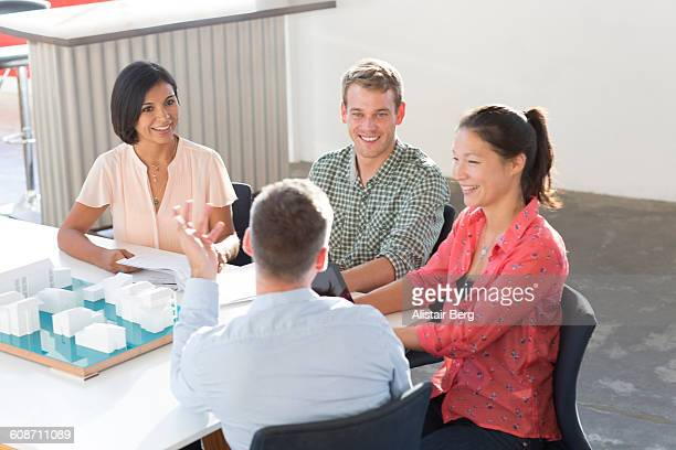business meeting in open office - leanintogether stock pictures, royalty-free photos & images