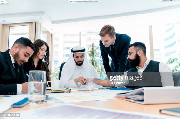 Business meeting in progress chaired by Arab Businessman