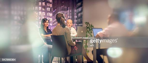 business meeting late at night - executive director stock pictures, royalty-free photos & images