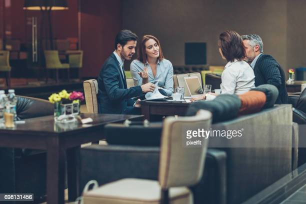 business meeting late in the evening - hotel lobby stock pictures, royalty-free photos & images
