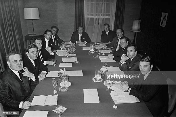 Business meeting of music managers, agents, and impresarios being held to formulate a guild for their profession, 3rd October 1964. Seated at the...