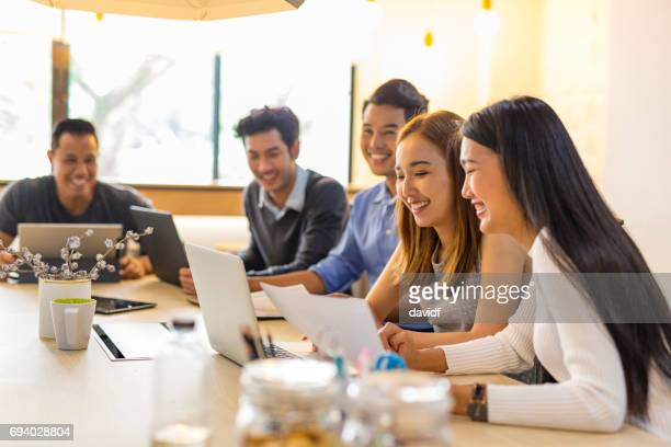 business meeting of young asian start up entrepreneurs - east asian culture stock photos and pictures