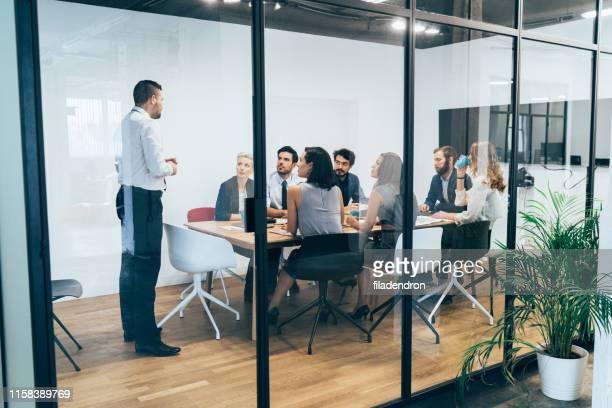 reunião de negócio - reunião de equipe - fotografias e filmes do acervo