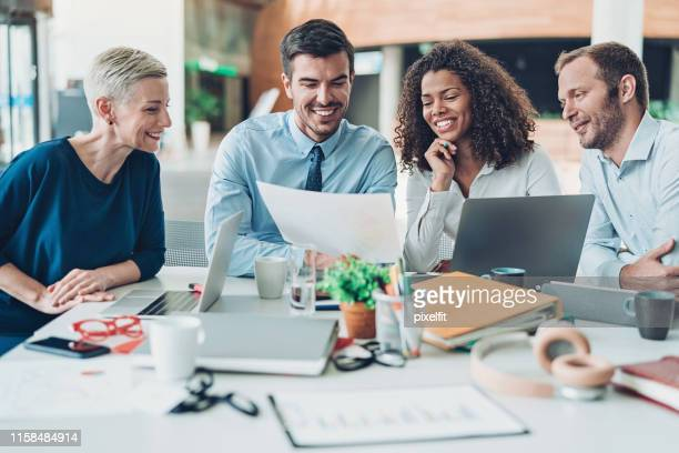 business meeting - annual report stock pictures, royalty-free photos & images
