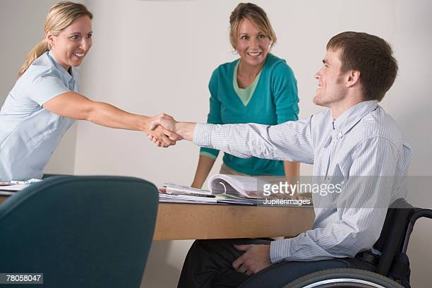 Business meeting with man in wheelchair