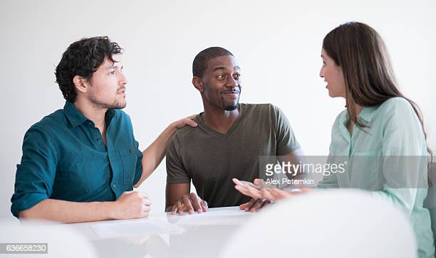 Business meeting. Young woman helping to understand financial documents