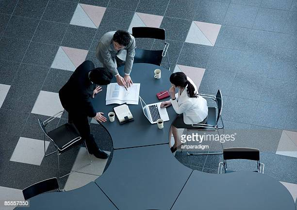 Business men and woman having a meeting
