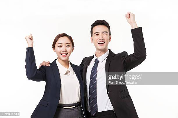 Business men and women have a fighting pose