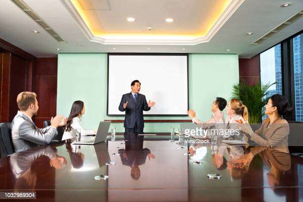 business men and women in a meeting - shareholder stock photos and pictures