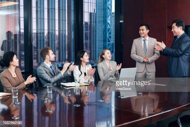 business men and women in a meeting - shareholder stock pictures, royalty-free photos & images
