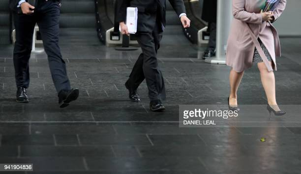 Business men and women walk in the City of London on April 4 2018 Employers with more than 250 staff have until midnight on Wednesday to publish the...