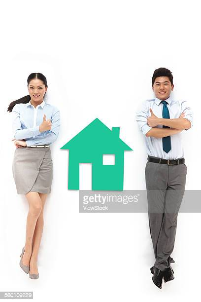 Business men and women with a building model
